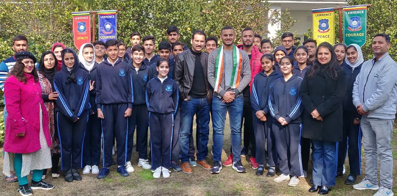 Abdul Samad with the students and management of the Lawrence Public School